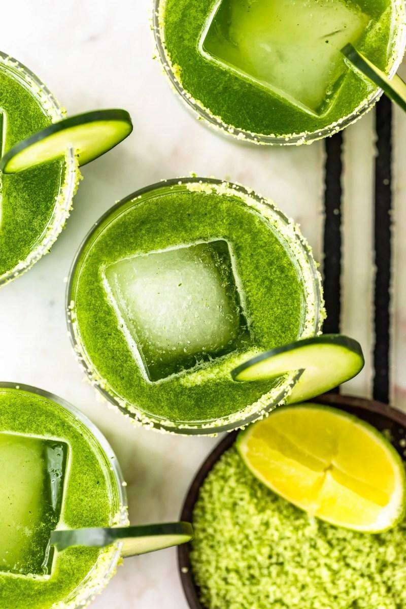 spicy cucumber margaritas overhead shot with cilantro salt