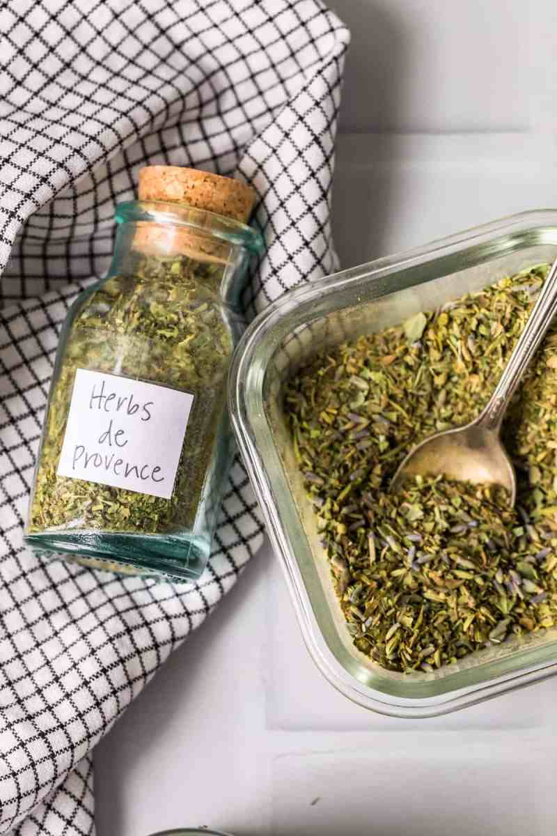 Herb mix in a glass jar and bowl