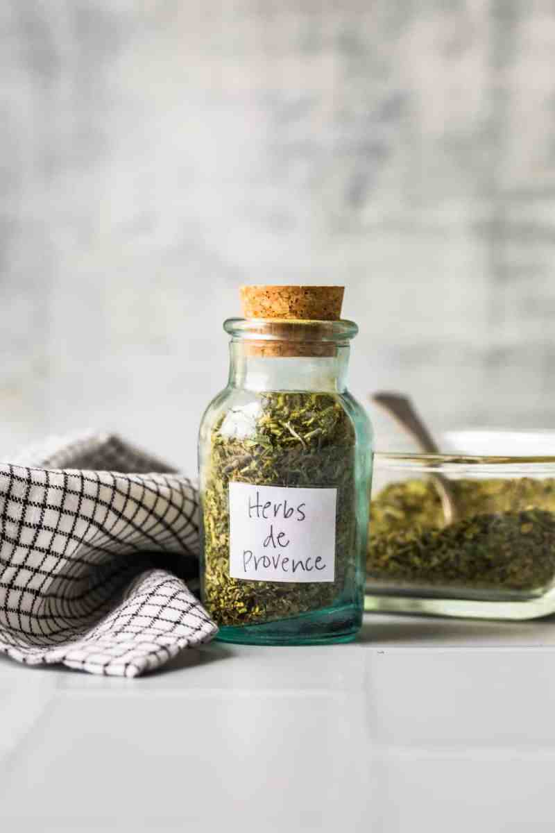 A jar of Herbs de Provence with a label