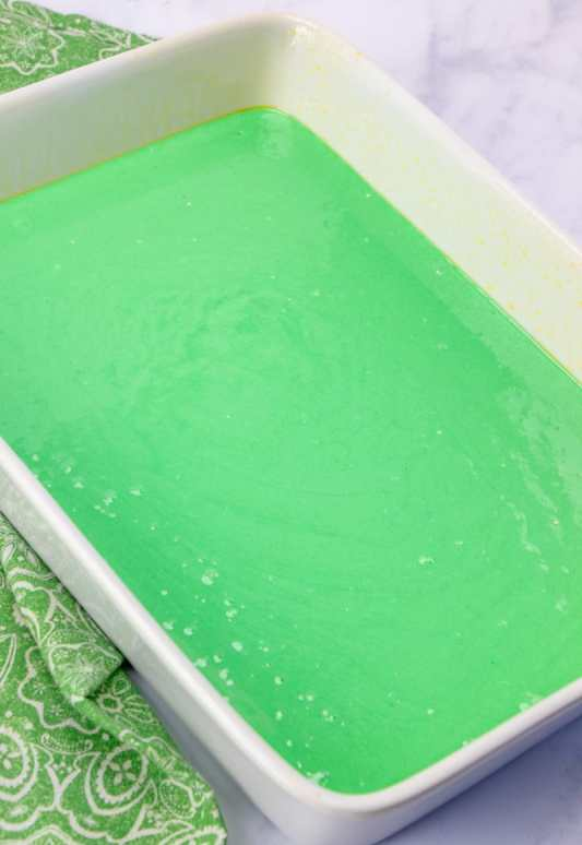 cake batter puree into greased 9x13 baking pan