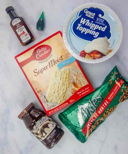white cake mix, hot fudge sauce, Andes creme de menthe chocolates, whipped topping, mint extract, green food coloring