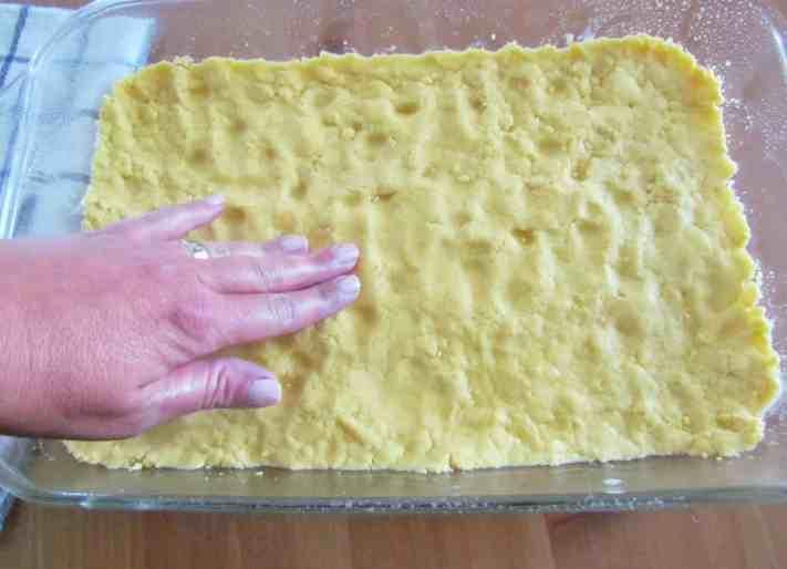 lemon cake mix spread into glass baking dish
