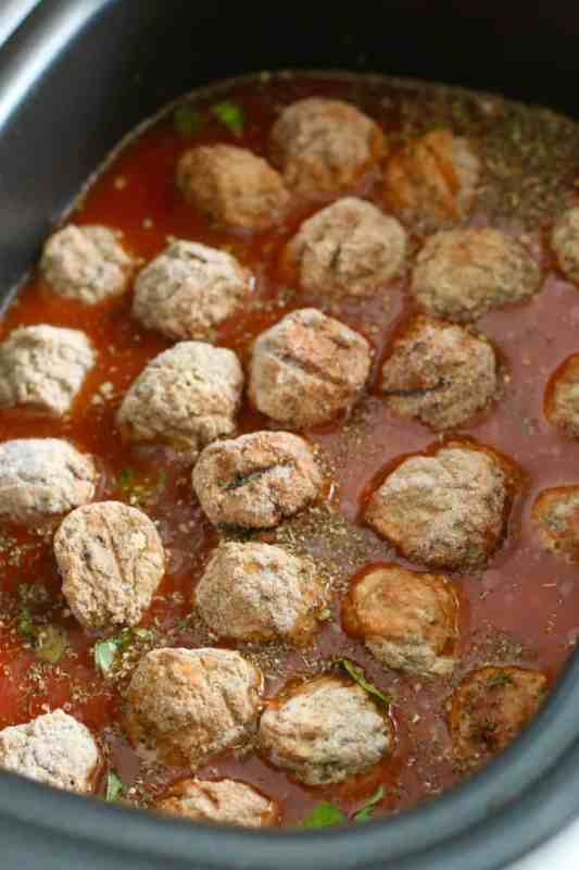 frozen meatballs added to slow cooker