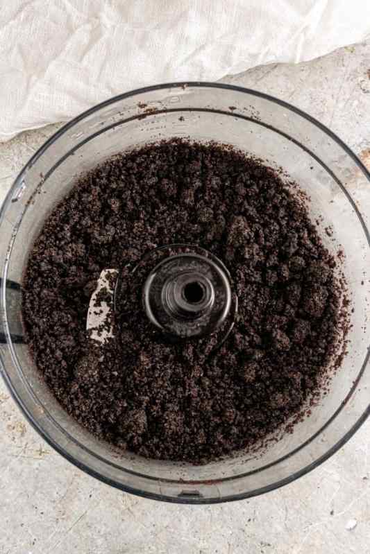 crushed Oreo cookies with melted butter mixed together in a food processor