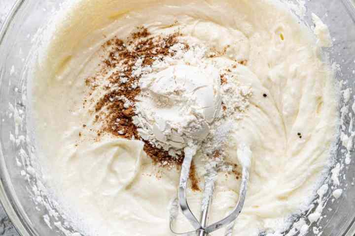 pumpkin pie spice, flour and salt added to butter and cream cheese mixture in a large, clear bowl