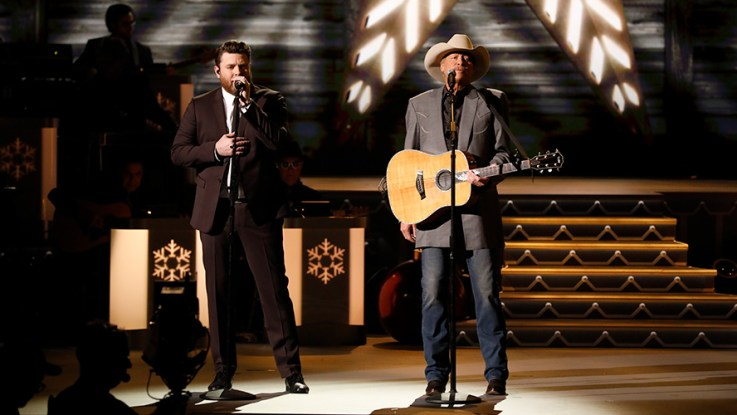 alan jackson and chris young perform theres a new kid in town during cma country christmas airing monday nov 27 on the abc television network