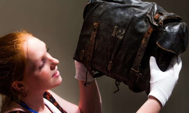 Learning and audiences officer Becca Berger with the satchel bag of Captain Sir Peter Halkett.