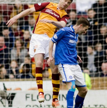 03/05/14 SCOTTISH PREMIERSHIP MOTHERWELL v ST JOHNSTONE FIR PARK - MOTHERWELL Motherwell's Stephen McManus goes head to head with Steven McLean (right).