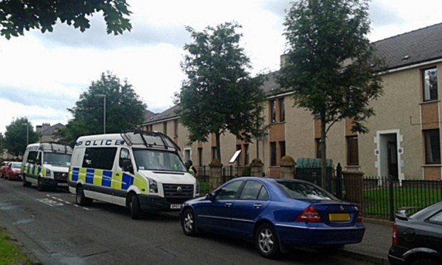 Officers raided the flat on Kingsway East on Tuesday morning.