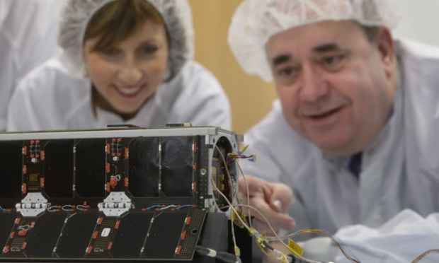 First Minister Alex Salmond (right) and Chief Executive of Scottish Enterprise Dr Lena Wilson inspect the UKube-1 satellite.