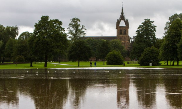 Picture of flood water at the South Inch with St Leonards-in-the-Fields Church in the background.