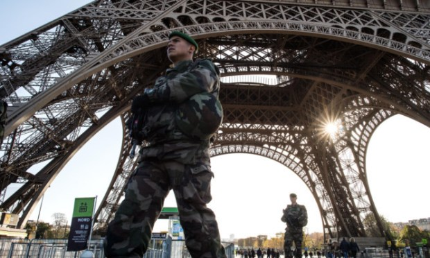 A French soldier stands guard at Eiffel Tower.