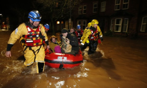 A family are rescued by the coastguard in the centre of Carlisle.