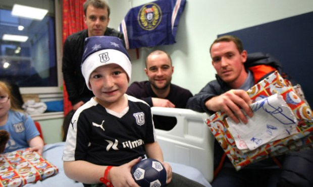 Dundee FC players made their annual visit to Ninewells Hospital on Tuesday. Players and staff brought sack loads of gifts for patients in the childrens medical ward, surgical ward and outpatient clinics and also visited adult patients in one of the orthopaedic wards. Fans also had the opportunity to get autographs and pose for photographs with their favourite players.