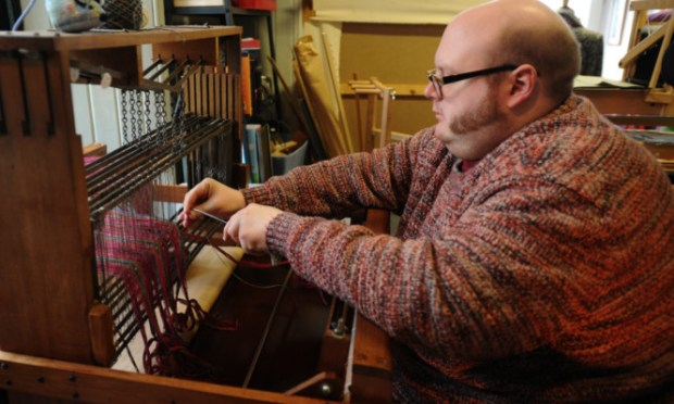 Ashleigh Slater, a Duncan of Jordanstone graduate who started weaving as a hobby and has now made a business from it.