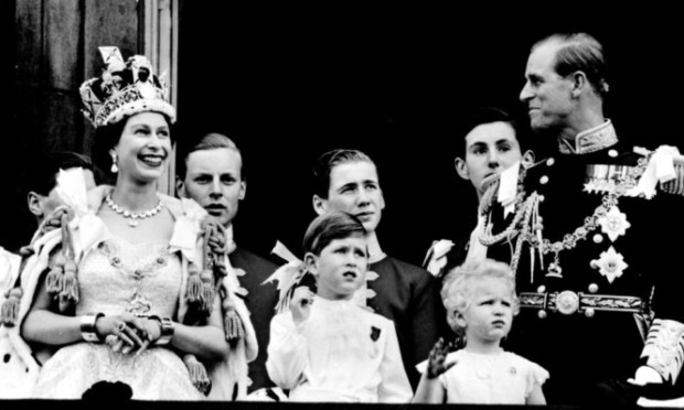 The royal family on the balcony of Buckingham Palace after the coronation at Westminster Abbey.