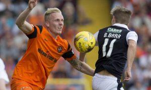 Dundee United's Nick van der Velden challenges Raith's Bobby Barr.
