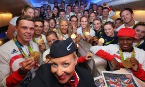 Part of the Great Britain Rio Olympics team take a selfie with their cabin crew