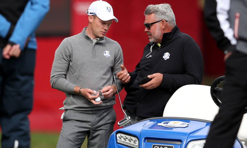 Europe's Danny Willett (left) chats with captain Darren Clarke (right) at Hazeltine.