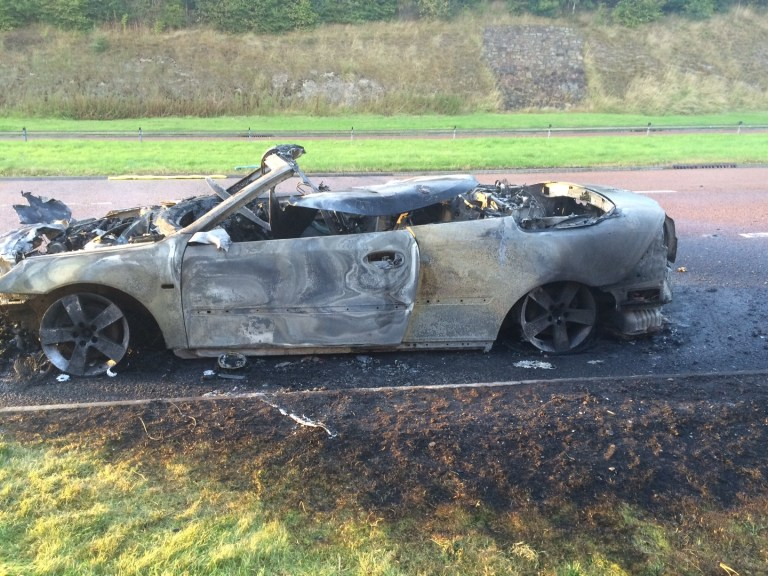 Burnt Saab 9-3 Convertible