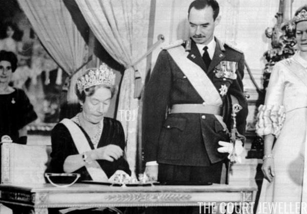 Charlotte wears the Empire Tiara to sign her abdication act as Jean and Josephine-Charlotte (wearing the Belgian Scroll Tiara) look on, November 1964