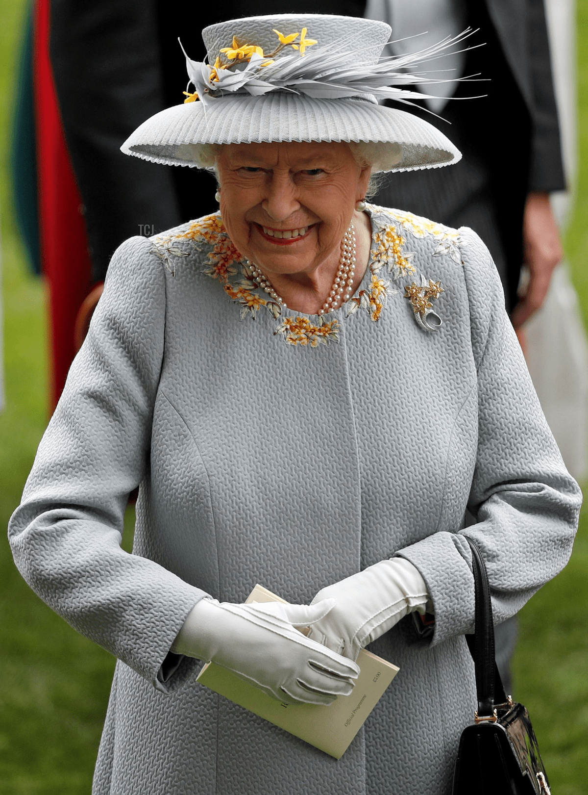 Britain's Queen Elizabeth II smiles as she attends day three of the Royal Ascot horse racing meet, in Ascot, west of London, on June 20, 2019