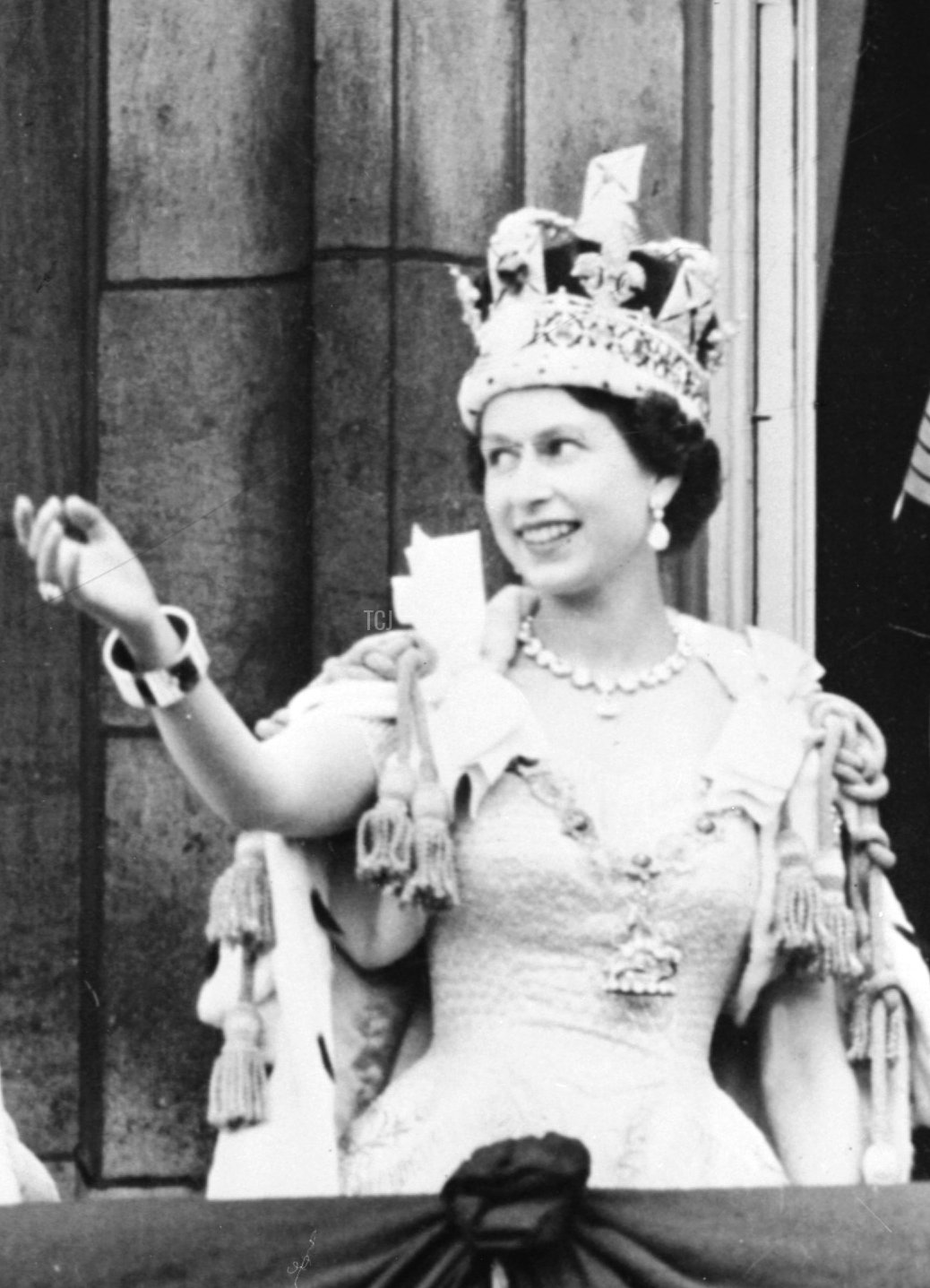 Britain's Queen Elizabeth II (L) accompanied by Britain's Prince Philip, Duke of Edinburgh (R) waves to the crowd, June 2, 1953 after being crowned at Westminter Abbey in London