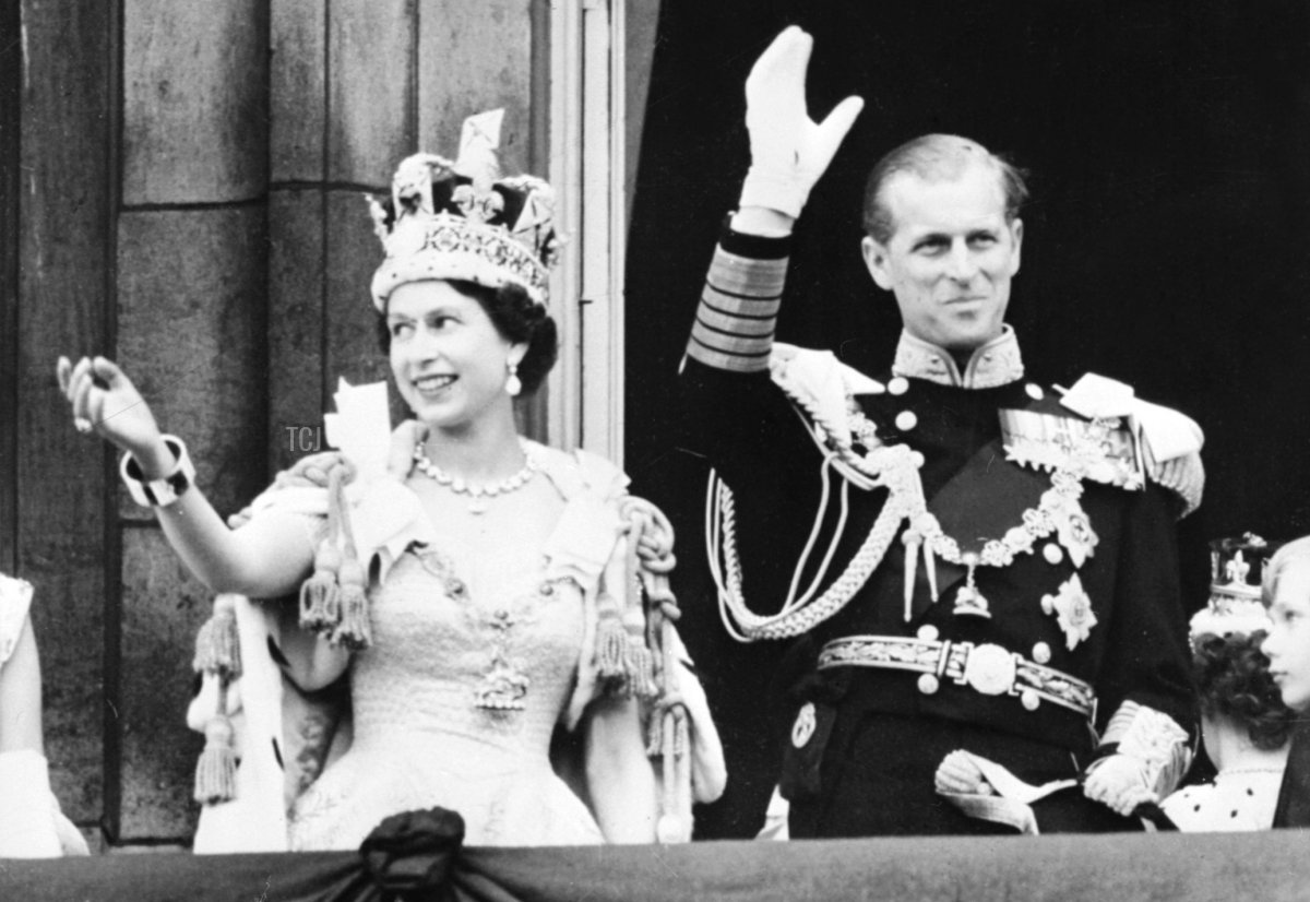 Britain's Queen Elizabeth II (L) accompanied by Britain's Prince Philip, Duke of Edinburgh (R) waves to the crowd, June 2, 1953 after being crowned at Westminter Abbey in London. - Elizabeth married the Duke of Edinburgh on the 20th of November 1947 and was proclaimed Queen in 1952 at age 25. Her coronation was the first worldwide televised event