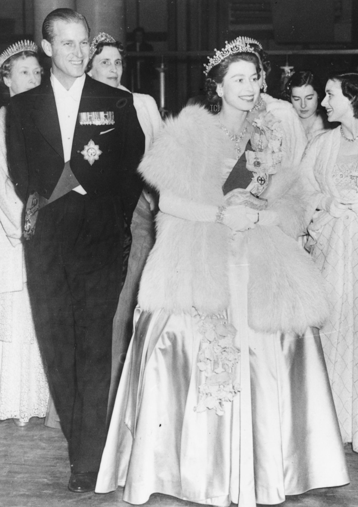 HM Queen Elizabeth II and Prince Philip, the Duke of Edinburgh, wearing formal dress as they attend a concert at Festival Hall, London, May 1951