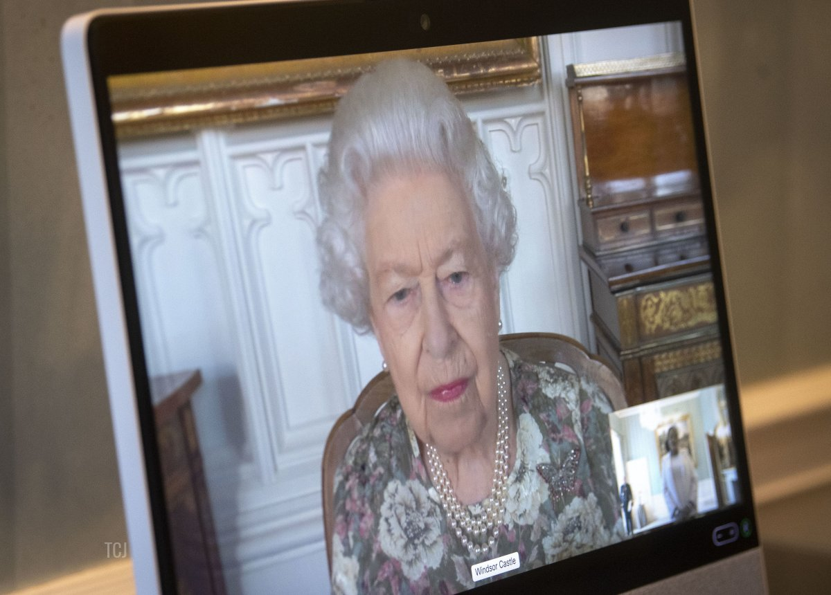 Queen Elizabeth II appears on a screen via videolink from Windsor Castle, where she is in residence, during a virtual audience to receive the Ambassador from the Republic of South Sudan, Agnes Oswaha, at Buckingham Palace on June 8, 2021