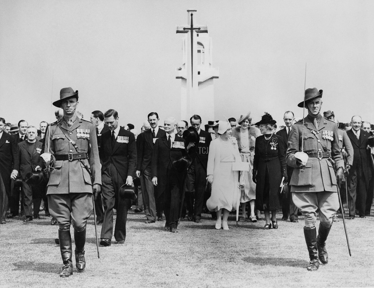 King George VI (1895 - 1952) and Queen Elizabeth (1900 - 2002) unveil the Villers–Bretonneux Australian National Memorial in the Somme, during their State Visit to France, 22nd July 1938. The Queen is wearing a dress from the White Wardrobe designed for her by Norman Hartnell to mark the death of her mother, the Countess of Strathmore