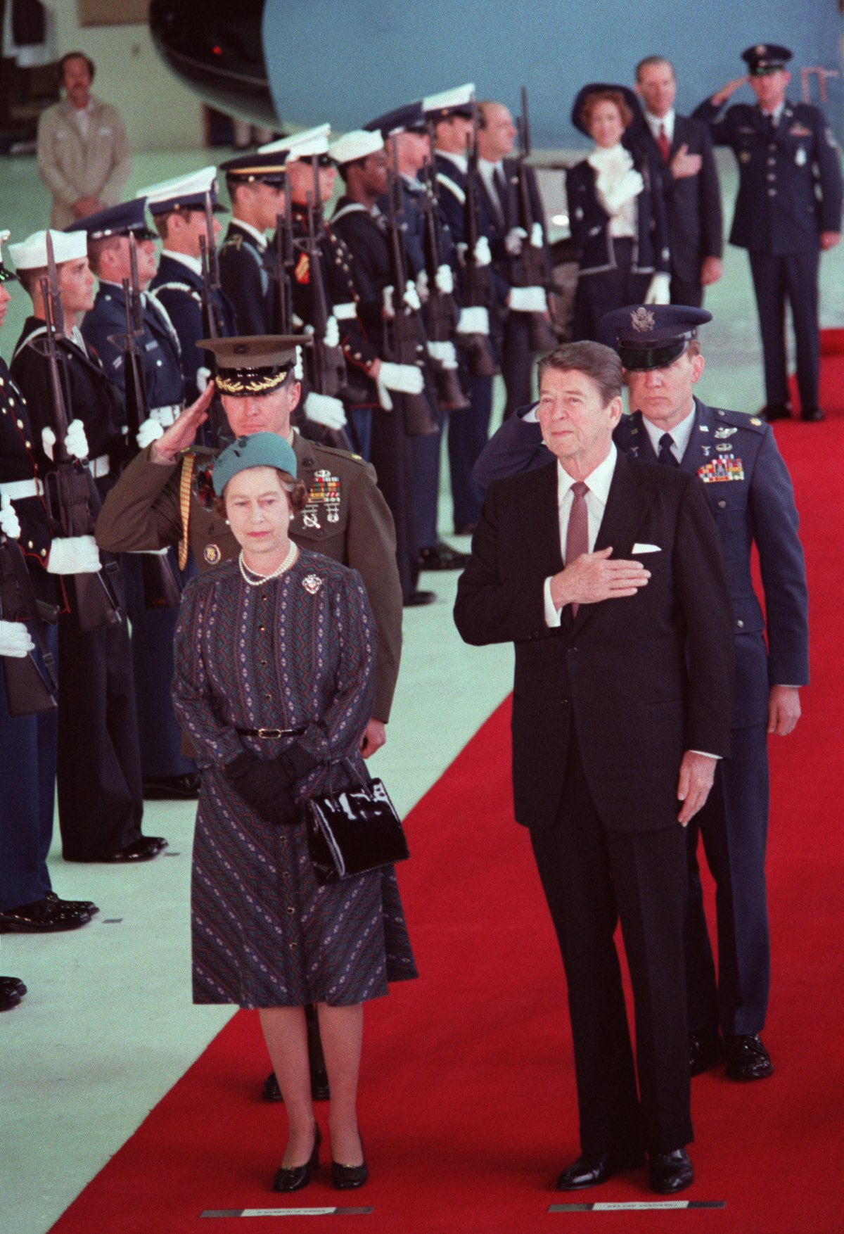 U.S. President Ronald Reagan stands with Queen Elizabeth II in Santa Barbara during a ceremony to honor her visit to the West Coast of the U.S.