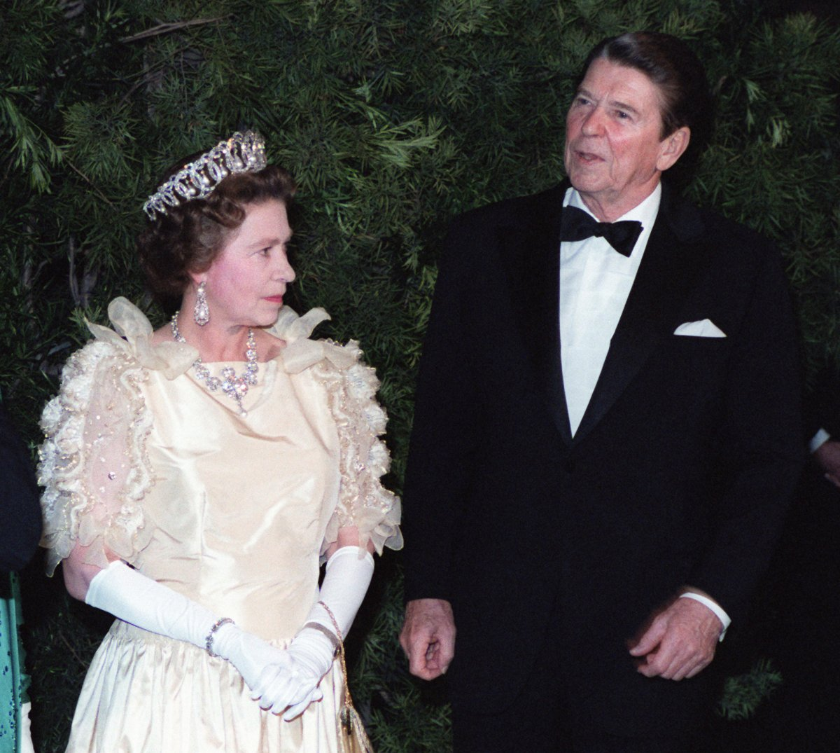 President and Mrs. Reagan attend a state dinner with Queen Elizabeth II and Prince Philip