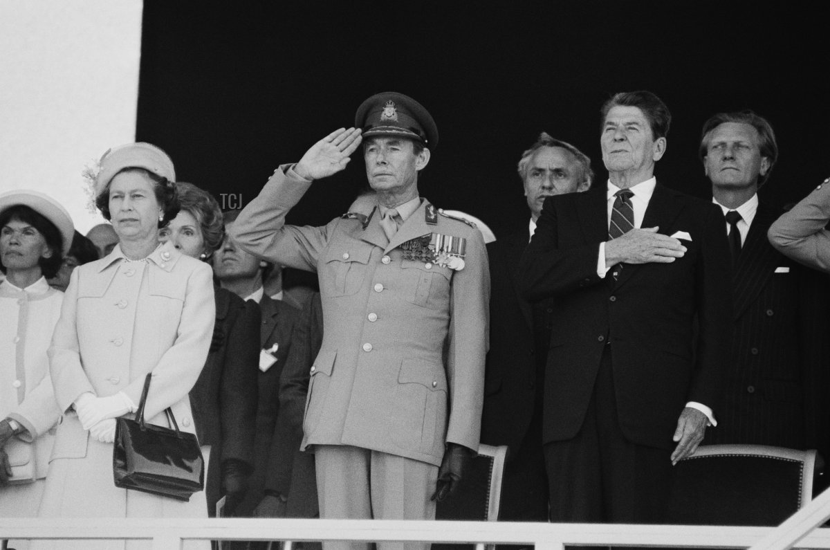 Queen Elizabeth II, American actress Nancy Reagan (1921 - 2016), Jean Grand Duke of Luxembourg (1921 - 2019), American politician and actor Ronald Reagan (1911 - 2004) and British politician and businessman Michael Heseltine at Utah Beach to commemorate the 40th anniversary of the D-Day, Normandy, France, 6th June 1984