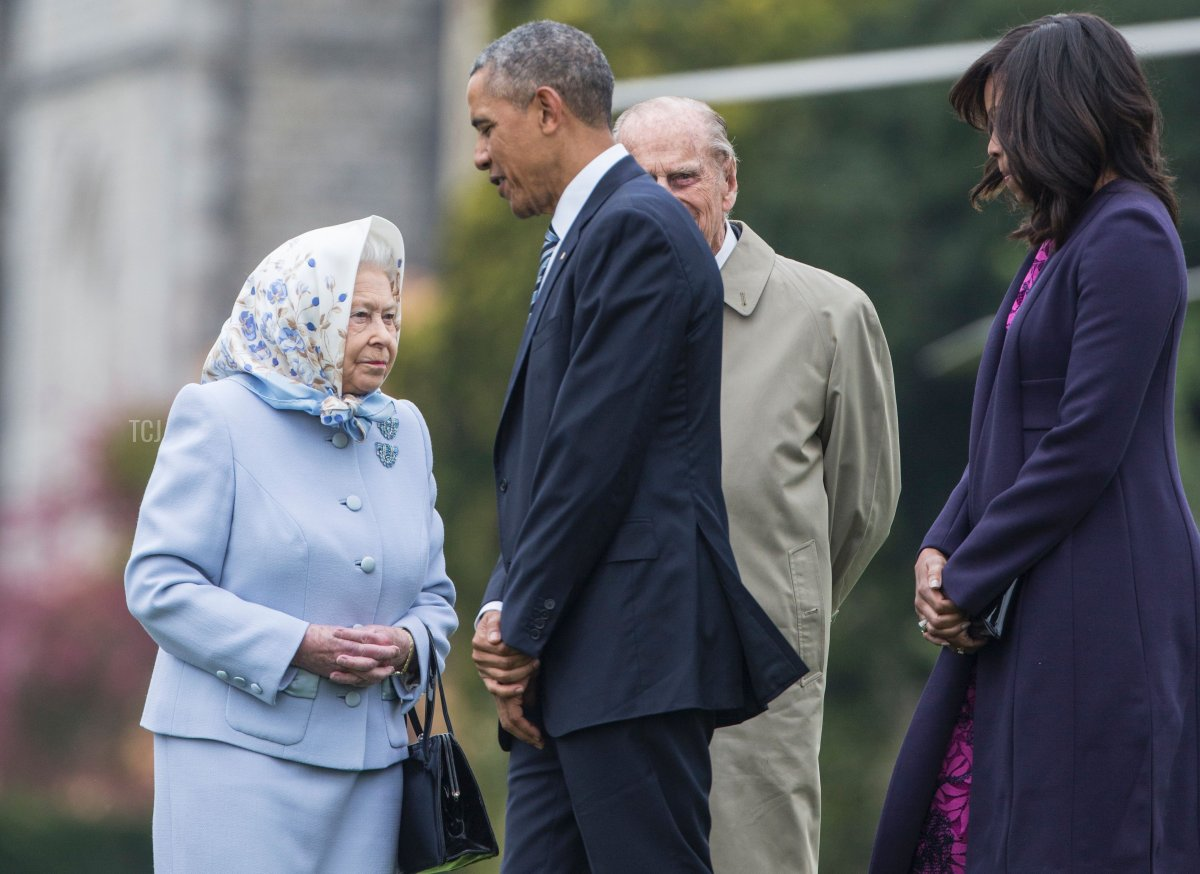 US President Barack Obama (2L) and his wife US First Lady Michelle Obama (R) are greeted by Britain's Queen Elizabeth II (L) and Prince Philip, Duke of Edinburgh, (2R) after landing by helicopter at Windsor Castle for a private lunch in Windsor, southern England, on April, 22, 2016
