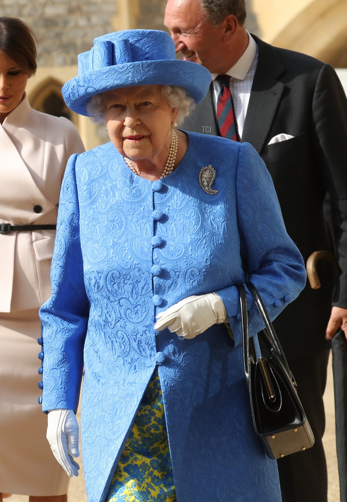 US President Donald Trump and Britain's Queen Elizabeth II leave the Quadrangle after inspecting a Guard of Honour at Windsor Castle in Windsor, west of London, on July 13, 2018 on the second day of Trump's UK visit