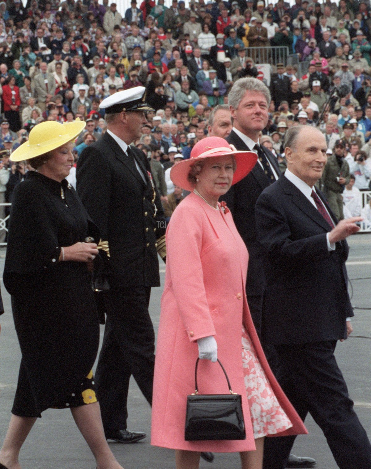 French President François Mitterrand (R) arrives for ceremonies during the commemoration of the 50th anniversary of D-Day 06 June 1994 at Omaha Beach. (From L-R) Czech President Vaclav Havel, Polish President Lech Walesa, non-unidentified, Dutch Queen Beatrix, Norwegian King Harald, Britain's Queen Elizabeth and US President Bill Clinton