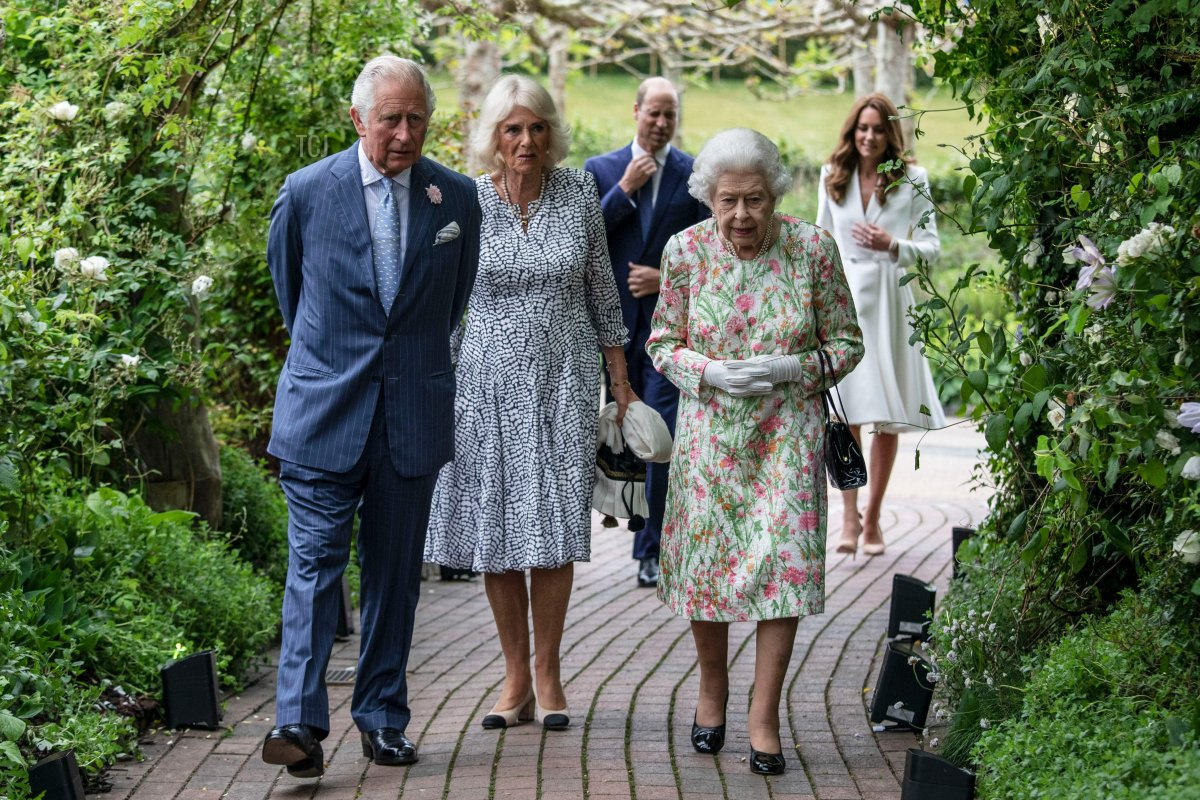 Britain's Prince Charles, Prince of Wales (L), Britain's Camilla, Duchess of Cornwall (C) and Britain's Queen Elizabeth II (R) attend a reception with G7 leaders at The Eden Project in south west England on June 11, 2021. - G7 leaders from Canada, France, Germany, Italy, Japan, the UK and the United States meet this weekend for the first time in nearly two years, for three-day talks in Carbis Bay, Cornwall