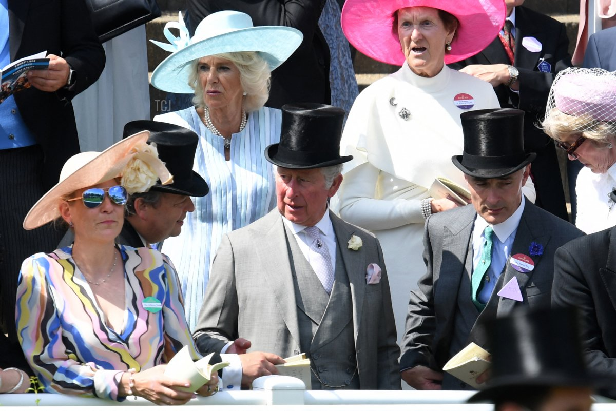 Britain's Prince Charles, Prince of Wales (bottom-C) andBritain's Camilla, Duchess of Cornwall (top-L) attend the first day of the Royal Ascot horse racing meet, in Ascot, west of London on June 15, 2021