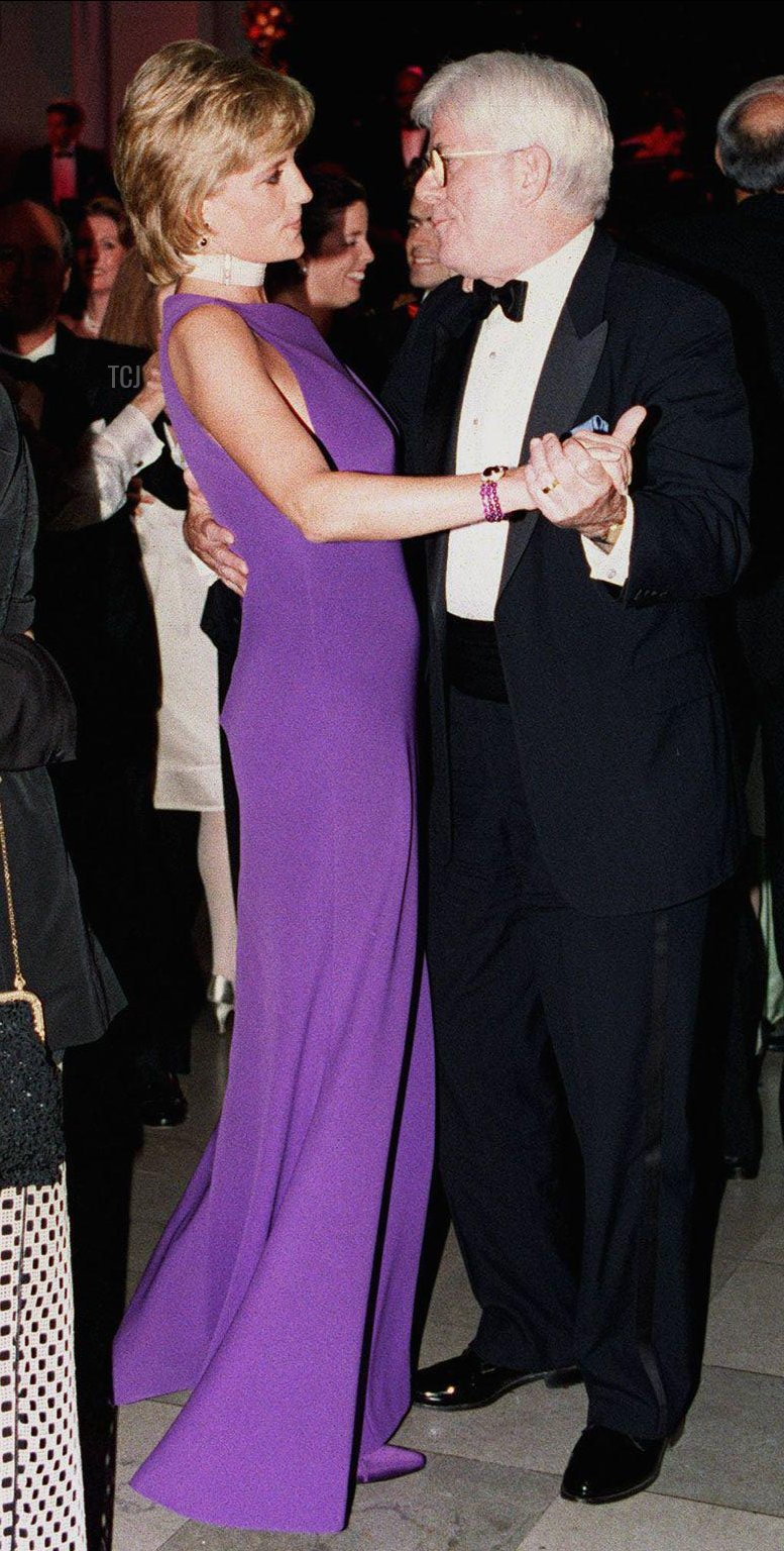 The Princess of Wales dances with Phil Donahue, the American TV chat show host, at the charity fund raising Gala dinner in Chicago, 5 Jun 1996