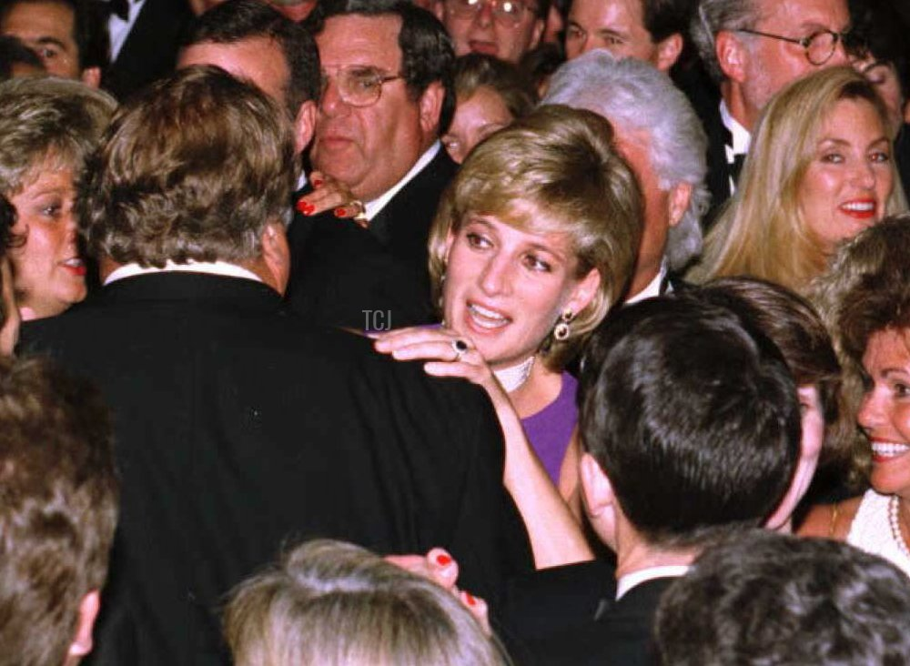 Princess Diana (C) dances with an unidentified partner following the Gala Dinner at the Field Museum of Natural History in Chicago 05 June 1996