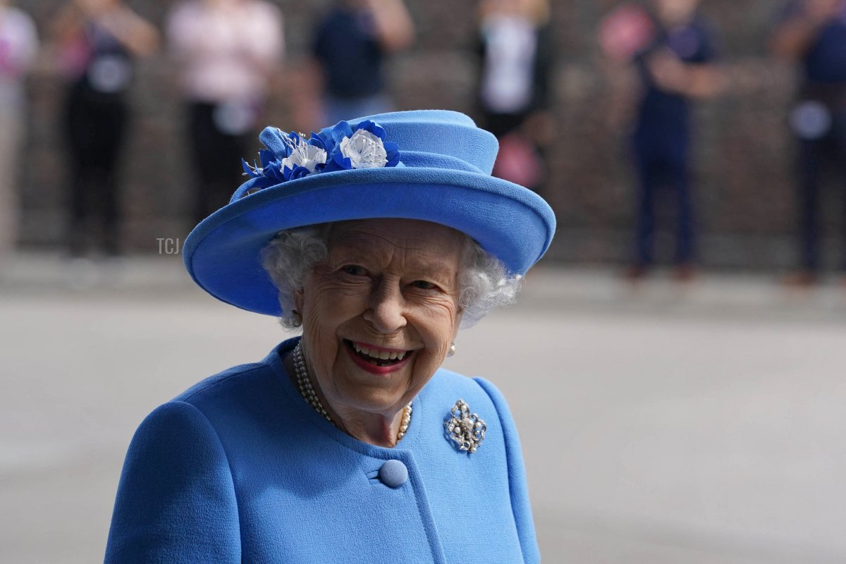 Britain's Queen Elizabeth II smiles as she visits AG Barr's factory in Cumbernauld, east of Glasgow, where the Irn-Bru drink is manufactured on June 28, 2021