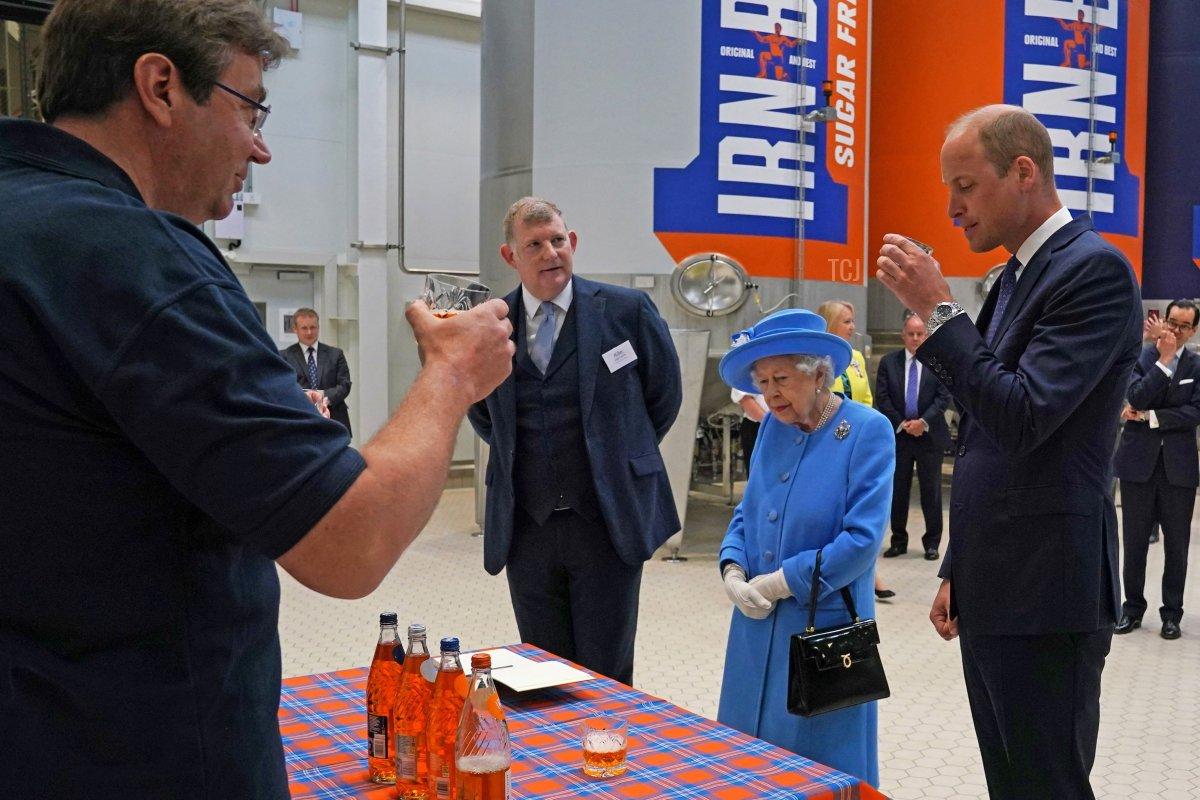 Britain's Prince William, Duke of Cambridge (R) samples Irn-Bru as he and Britain's Queen Elizabeth II visit AG Barr's factory in Cumbernauld, east of Glasgow, where the Irn-Bru drink is manufactured on June 28, 2021