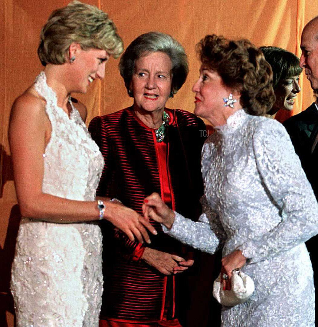 Princess Diana of Wales (L) and Washington Post owner Katharine Graham (C) greet Elizabeth Dole, wife of US Republican presidential candidate Bob Dole, in the reception line during a multi-million dollar fundraising event for the Nina Hyde Center for Breast Cancer Research late 24 September 1996 in Washington, DC