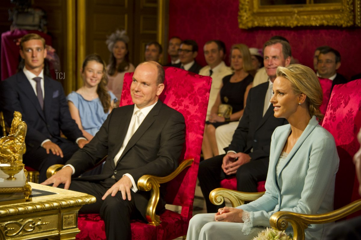 In this handout image provided by the Palais Princier, Prince Albert II of Monaco and Princess Charlene of Monaco are seated in the Throne Room during the civil ceremony of their Royal Wedding at the Prince's Palace on July 1, 2011 in Monaco