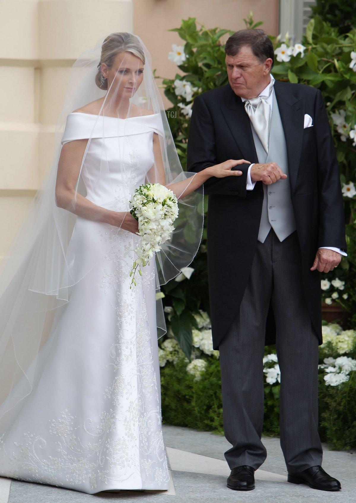 Princess Charlene of Monaco and Michael Kenneth Wittstock arrive at the religious ceremony of the Royal Wedding of Prince Albert II of Monaco to Princess Charlene of Monaco at the Prince's Palace of Monaco on July 2, 2011 in Monaco