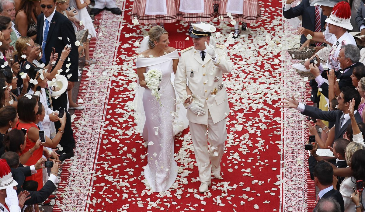 Princess Charlene of Monaco and Prince Albert Of Monaco smile as they leave the palace after the religious ceremony of the Royal Wedding of Prince Albert II of Monaco to Charlene Wittstock in the main courtyard at Prince's Palace on July 2, 2011 in Monaco