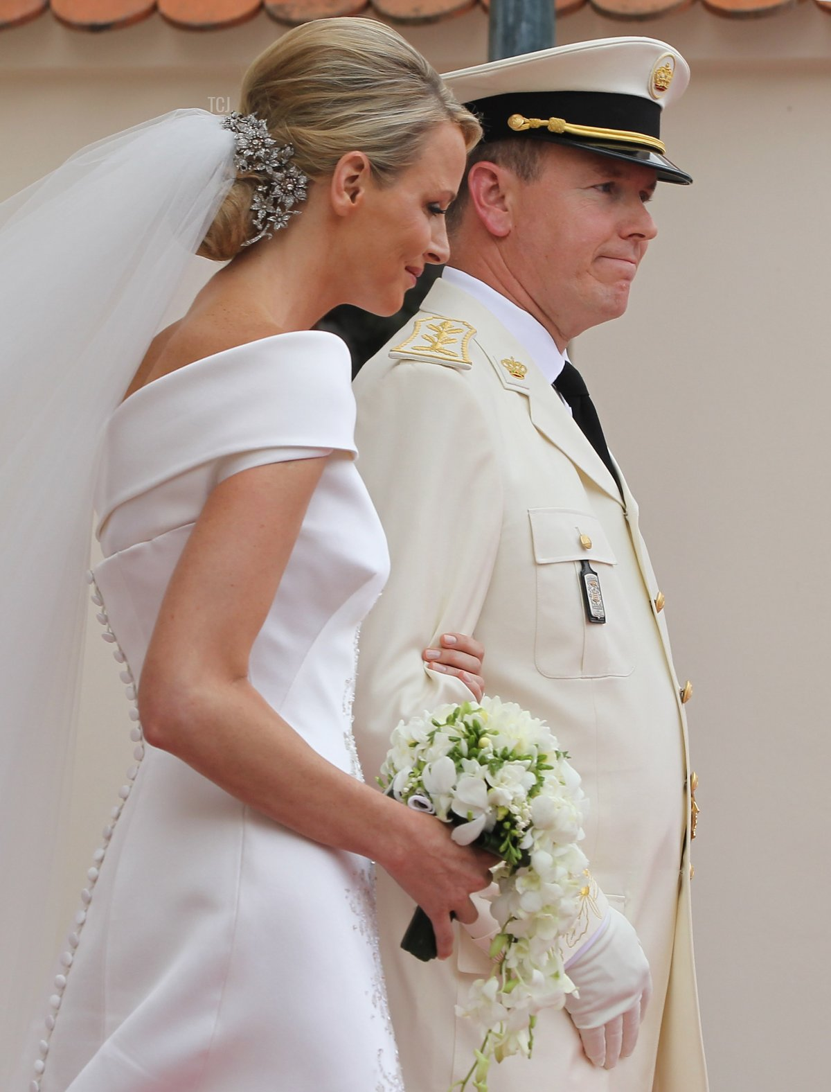 Princess Charlene of Monaco and Prince Albert II of Monaco leave the Prince's Palace after the religious ceremony of their Royal Wedding on July 2, 2011 in Monaco