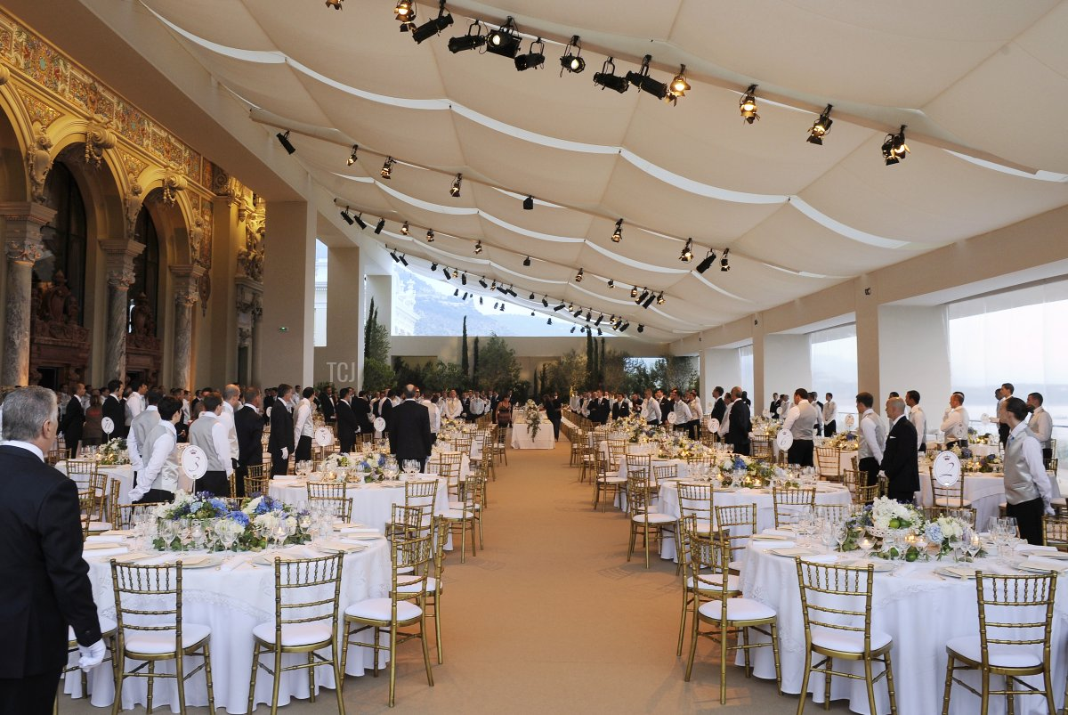 A picture shows waiters working at the Opera Terraces before the dinner following the religious wedding ceremony of Prince Albert II of Monaco and Princess Charlene of Monaco on July 2, 2011 in Monaco