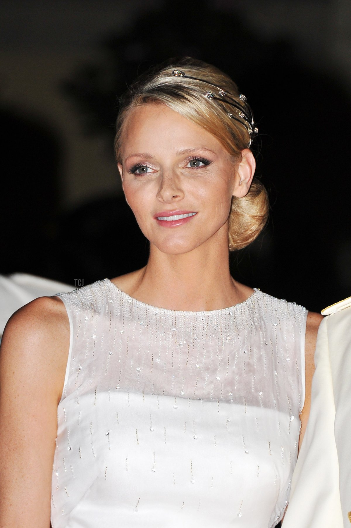 Princess Charlene of Monaco attends a dinner at Opera terraces after their religious wedding ceremony on July 2, 2011 in Monaco